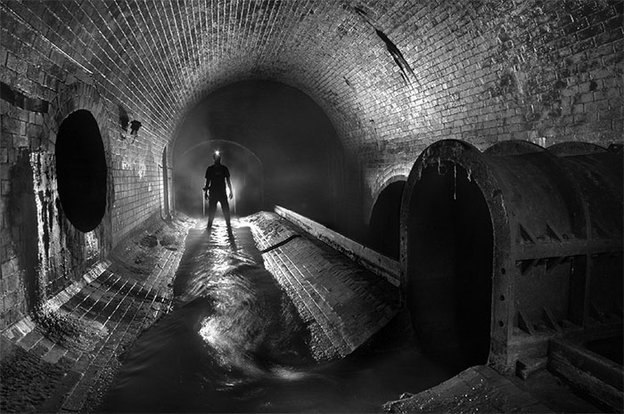 Person in a dark, foreboding tunnel